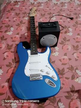 Electric Guitar With Amplifier And All Accessories