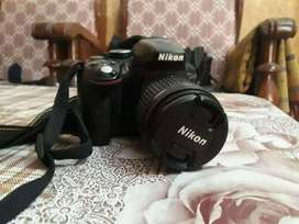 Nikon d 60 with betry charger and manual 70 300 mm lense