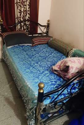 Wrought I ron queen size bed , 2 years old , along with mattress