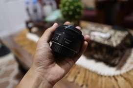 lensa fix 50mm STM