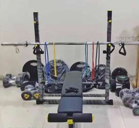 Dumbbells, plates, bench and rods