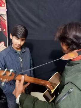 Guitar and flute teacher in Lahore xx DHA phase 3