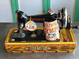 Olympia Sewing Machine Double Chal & Link Motion are Available in Atok