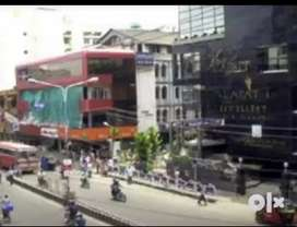 3 shops getting rent of 30000 at kaloor junction road front