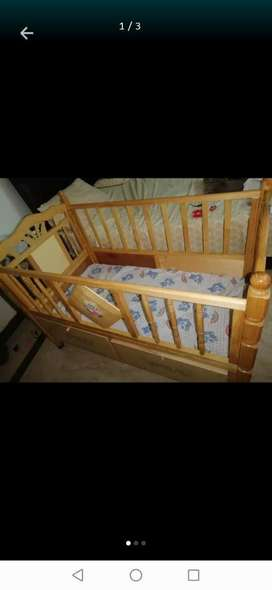 Baby cot with swing.