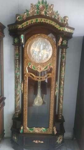 Jam jumbo jepara jati antik motif bulu macam anggun mewah