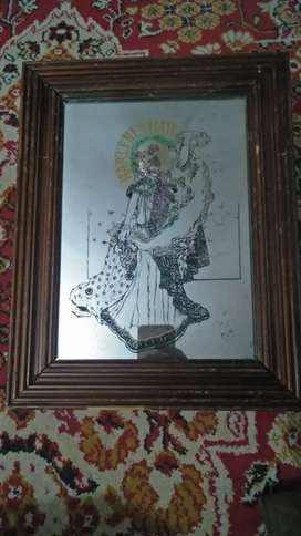 Beautiful antique old mirror with image