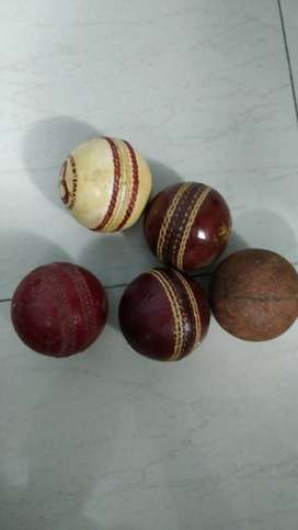 3 leather balls 1 synthetic and 1 cork ball. perfect condition.
