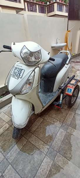 Scooty with side car