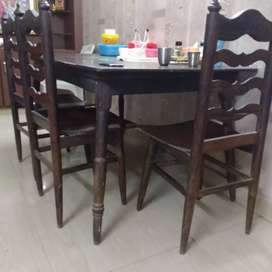 Rosewood dinning table with 3 Rosewood chairs.