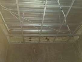 Tukang bangunan profesional