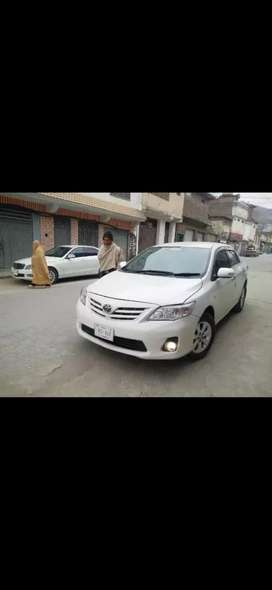 Toyota Corolla 2014  model available for rent with Driver