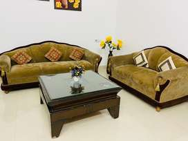 5 seater sofa with glass table in the centre available.