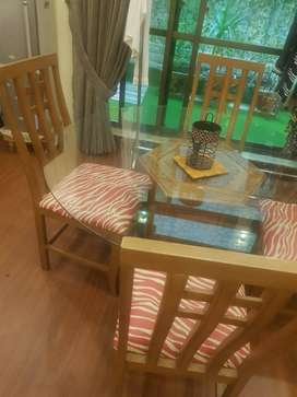 Round dining table set with matching two-seater sofa