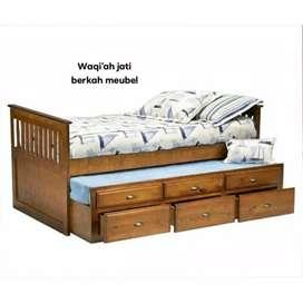 Tempat tidur anak sorong /dorong modern laci 3, bahan kayu jati asli