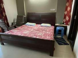 Bed, bedding and side table for sale
