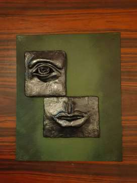 Clay sculpture on canvas
