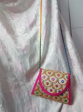 A beautiful sling purse for your best occasion.