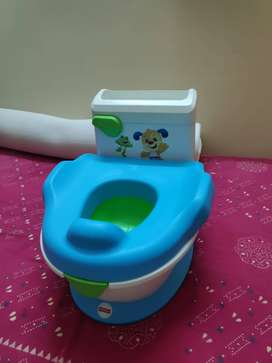 Potty Training Chair Fisher-Price  ( New Piece - Not used)