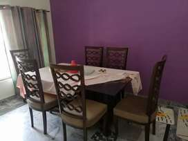 Dinning table with glass top and six chairs