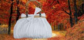 white colored thread decorated good conditioned lightweight hand bag