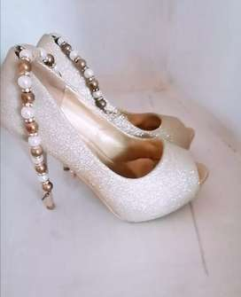 Golden bridal shoe