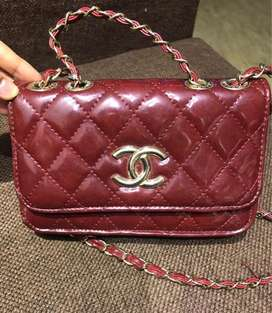 Maroon medium size bag with double chain