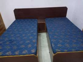 Double bed with side table and without mattress
