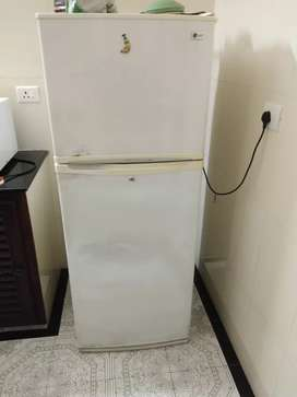 L. G two door refrigerator 8 years old.