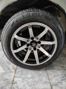 Almost New tyre and rim for sale