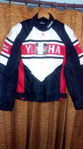 Yamaha original jeket red and bleck color and helmet waite color