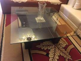 table made of wood with glass on it