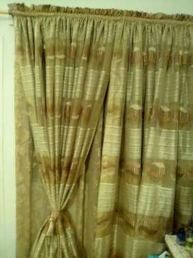 Brown and foan curtains.