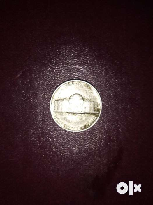 Round Silver-colored Coin 0