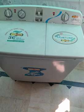 Super asia washing machine with built in drayer in good condition