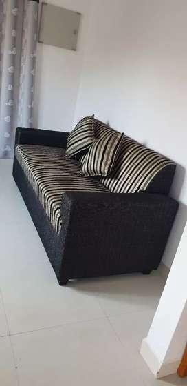 Three seater sofa brand new