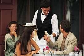 Waiter with kitchen helper