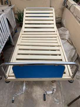 Hospital bed for sale in mint conditionhardly used wd washable matress