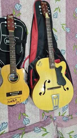 Givson Guitar and Kids Guitar both guitar 4000