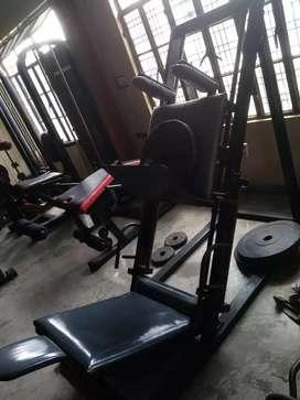 Thigh press and squat machine