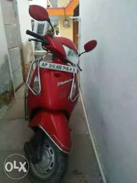 Red and black colour scooter