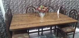 Dining table with 6 chairs urgent sale.
