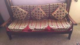 Five seater wooden sofa with wooden center table