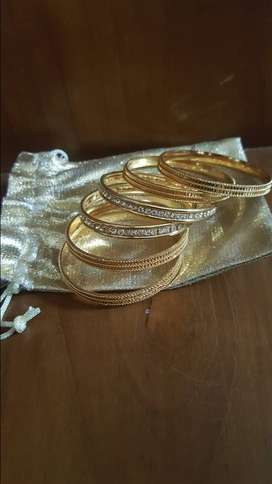 Kids shinning gold cotted bangles with bangle cover for sale.