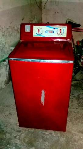 New condition washing machine in red colour