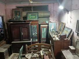 Old and antique cupboard,dining table, dressing table,big glass