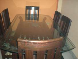 Glass top 6 seater dinning table. rarely used