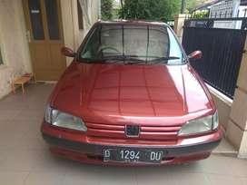 Peugeot 306 merah