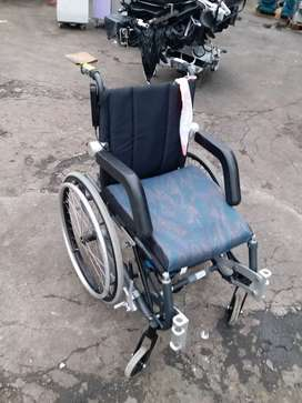 Wheel chair with up stand remote system
