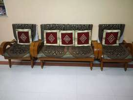 Wooden sofa with cover and cushion